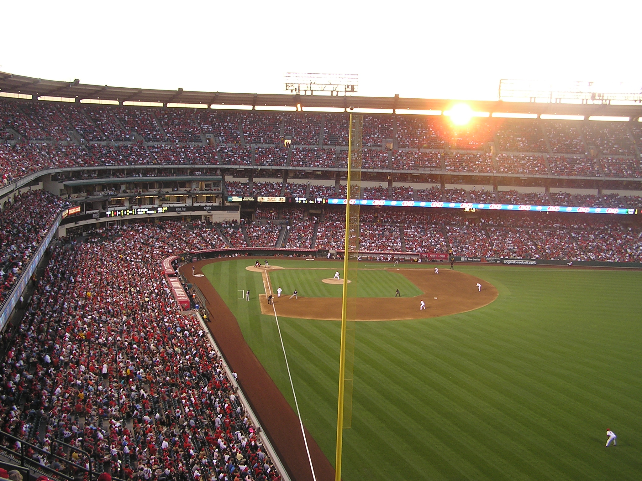 The Sun sets through the opening at Angel Stadium